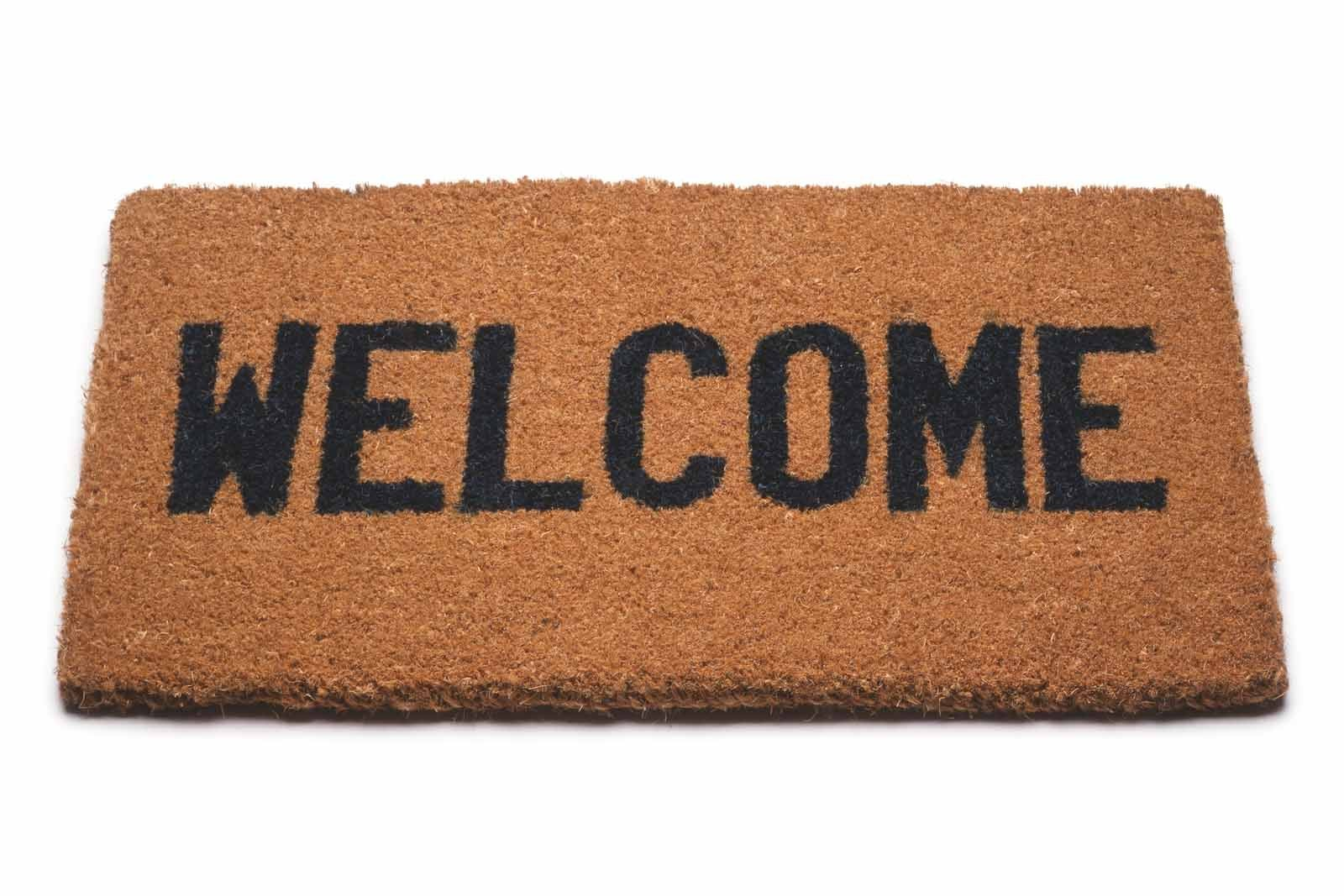 "A welcome mat that says ""Welcome."""
