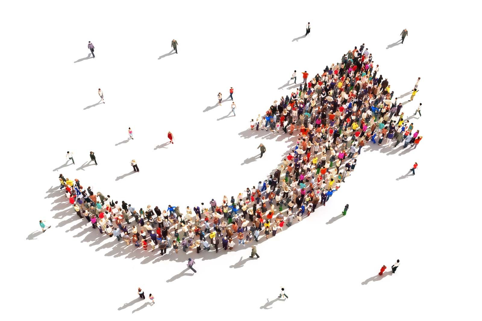 Large group of people forming an arrow, aerial view.