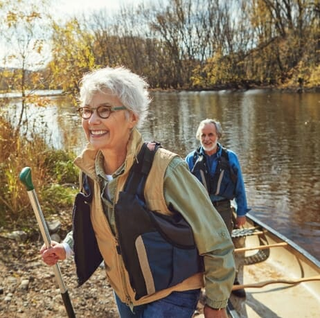 Woman and man out canoeing to illustrate benefits of Phreesia's Care Pathways for Geriatric Medicine application