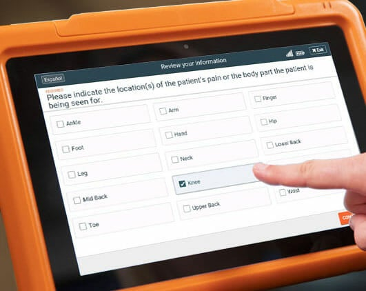 Sample orthopedic practice patient intake form on the PhreesiaPad tablet, patient indicating knee problems