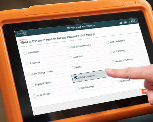 Sample urgent care practice patient intake form on the PhreesiaPad tablet, patient indicating painful urination